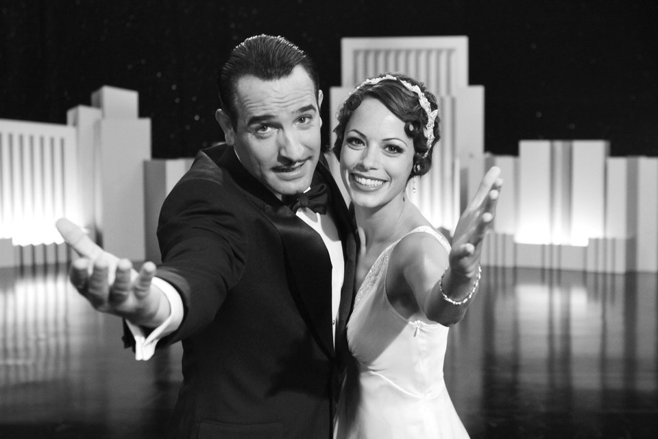 """In this film publicity image released by The Weinstein Company, Jean Dujardin portrays George Valentin, left, and Berenice Bejo portrays Peppy Miller in a scene from """"The Artist."""" (AP Photo/The Weinstein Company) ORG XMIT: NYET526"""