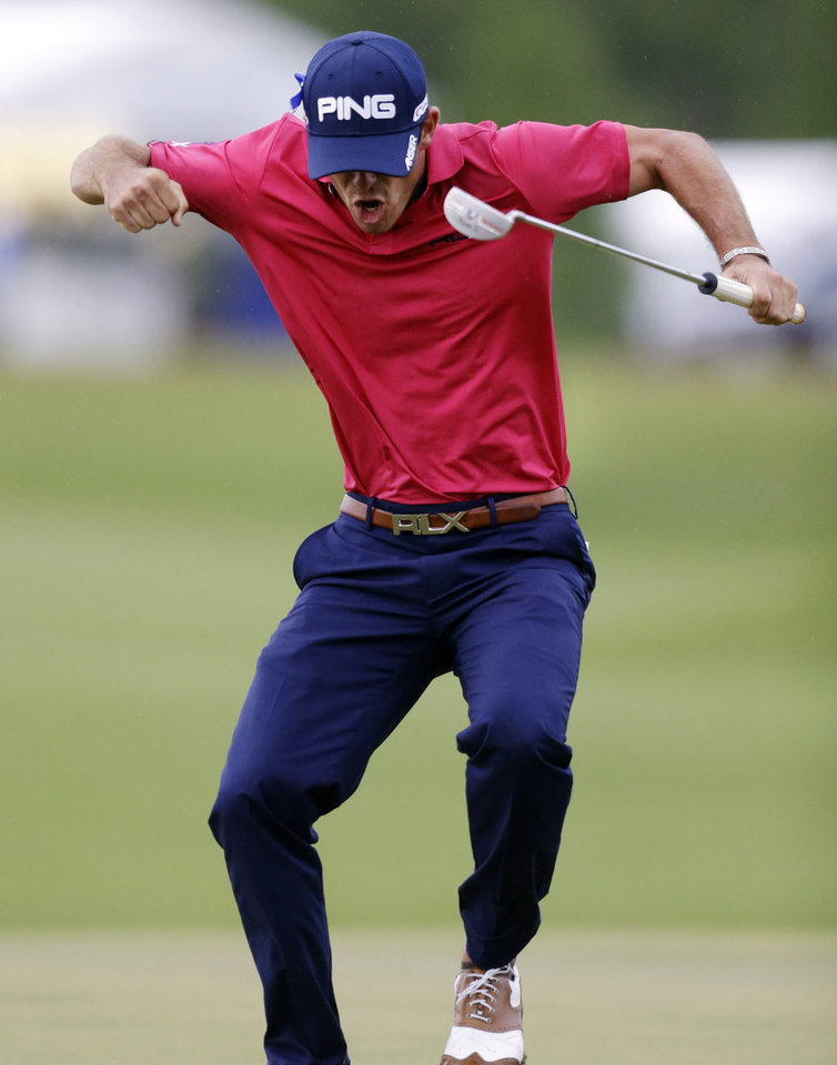 Photo - Billy Horschel celebrates after sinking a birdie putt on the 18th green to win the PGA Zurich Classic golf tournament at TPC Louisiana in Avondale, La., Sunday, April 28, 2013. (AP Photo/Gerald Herbert)