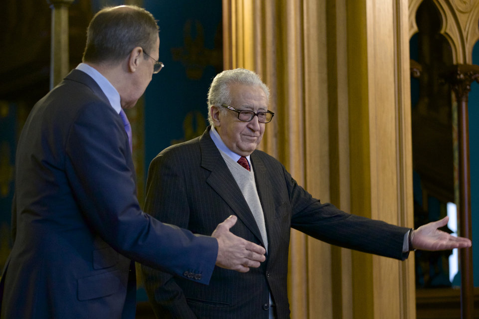 Photo - Russian Foreign Minister Sergey Lavrov, left, welcomes U.N. envoy for Syria Lakhdar Brahimi during their meeting in Moscow, Russia, on Saturday, Dec. 29, 2012. (AP Photo/Ivan Sekretarev)