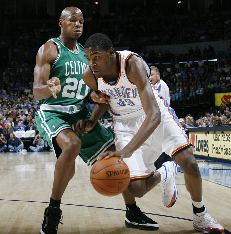 Photo - Kevin Durant of the Thunder drives past Ray Allen of Boston in the first half during the NBA basketball game between the Oklahoma City Thunder and the Boston Celtics at the Ford Center in Oklahoma City, Wednesday, Nov. 5, 2008. BY NATE BILLINGS, THE OKLAHOMAN ORG XMIT: KOD