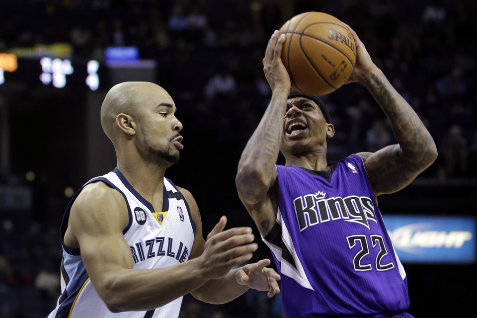 Photo - Sacramento Kings' Isaiah Thomas (22) shoots over Memphis Grizzlies' Jerryd Bayless, left, during the first half of an NBA basketball game in Memphis, Tenn., Friday, Jan. 18, 2013. (AP Photo/Danny Johnston)