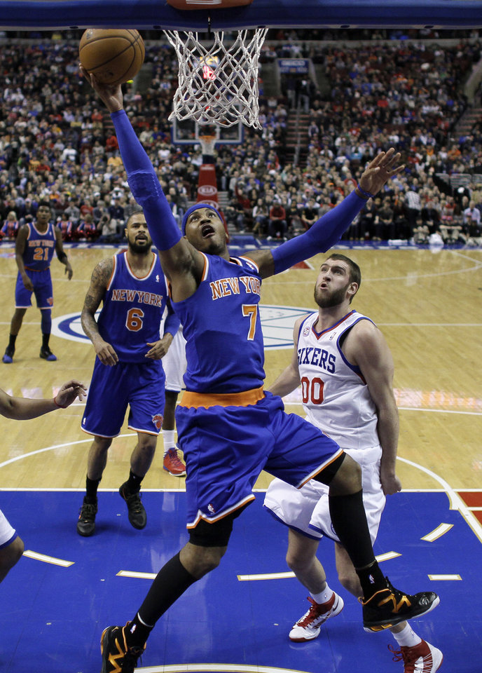 Photo - New York Knicks' Carmelo Anthony (7) shoots past Philadelphia 76ers' Spencer Hawes (00) during the first half of an NBA basketball game on Saturday, Jan. 26, 2013, in Philadelphia. (AP Photo/Matt Slocum)