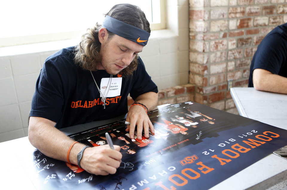 Photo - Quinn Sharp signs a poster during Oklahoma State's Fan Appreciation Day at Gallagher-Iba Arena in Stillwater, Okla., Saturday, Aug. 4, 2012. Photo by Sarah Phipps, The Oklahoman