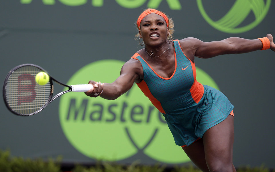 Photo - Serena Williams returns to Li Na, of China, during the women's final at the Sony Open Tennis tournament, Saturday, March 29, 2014, in Key Biscayne, Fla. (AP Photo/Lynne Sladky)