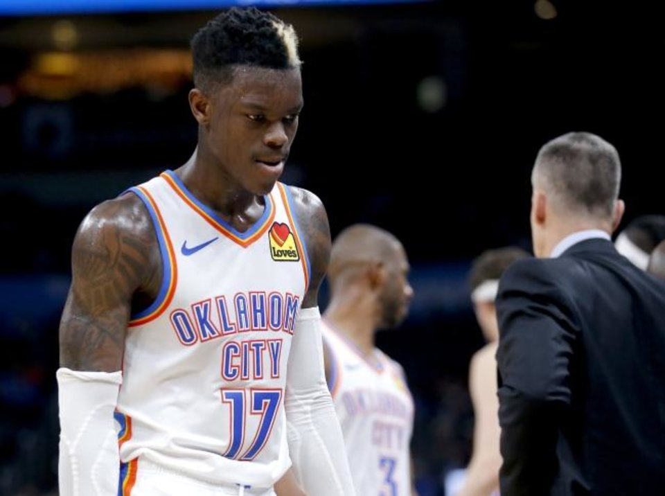 Photo -  Oklahoma City's Dennis Schroder walks off the court in the final seconds of Thursday night's game against Memphis at Chesapeake Energy Arena. OKC lost 110-97 to snap a five-game win streak at home. [Sarah Phipps/The Oklahoman]