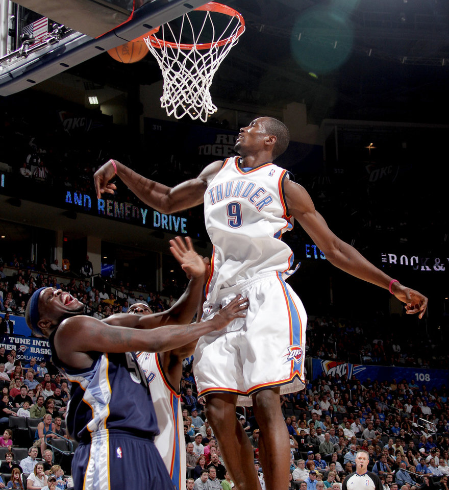 Oklahoma City\'s Serge Ibaka blocks the shot of Zach Randolph of Memphis during the NBA basketball game between the Oklahoma City Thunder and the Memphis Grizzlies at the Ford Center in Oklahoma City on Wednesday, April 14, 2010. Photo by Bryan Terry, The Oklahoman