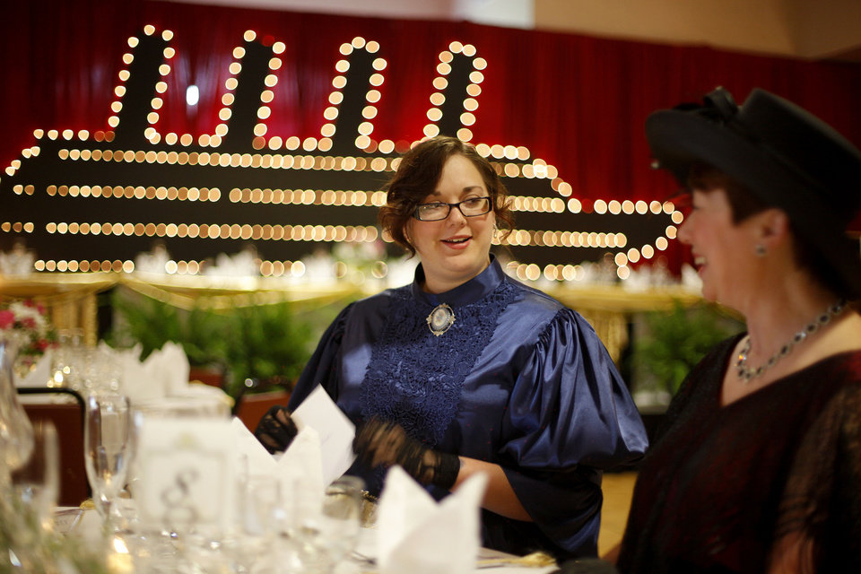 Amanda Wiles, left, and her mother, Janice Modisette, sit down for dinner during a Titanic-themed fundraiser for the Rose State scholarship fund. Photo by Bryan Terry, The Oklahoman BRYAN TERRY - THE OKLAHOMAN