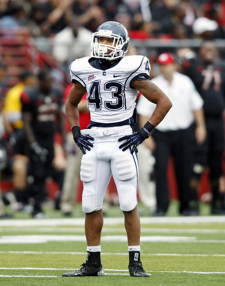 Photo -   Connecticut running back Lyle McCombs (43) stands on the field during the second half of an NCAA college football game against Rutgers in Piscataway, N.J., Saturday, Oct. 6, 2012. Rutgers won 19-3. (AP Photo/Mel Evans)