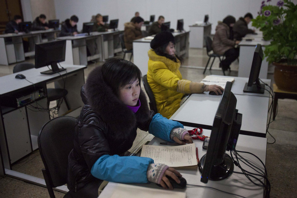 Photo - North Koreans work at computer terminals inside the Grand People's Study House in Pyongyang, North Korea on Wednesday, Jan. 9, 2013. (AP Photo/David Guttenfelder)