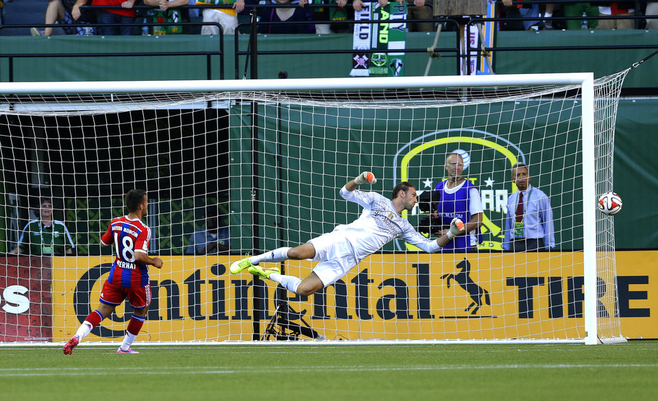 Photo - Bayern Munich goalkeeper Tom Starke dives for the ball in the first half of the MLS All-Star soccer game against the MLS All-Stars, Wednesday, Aug. 6, 2014, in Portland, Ore. (AP Photo/Ted S. Warren)