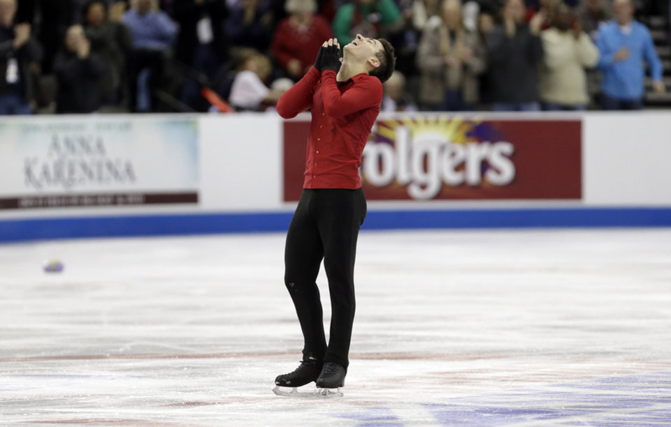 Max Aaron reacts after competing the senior mens free skate program at the U.S. figure skating championships, Sunday, Jan. 27, 2013, in Omaha, Neb. (AP Photo/Charlie Neibergall)