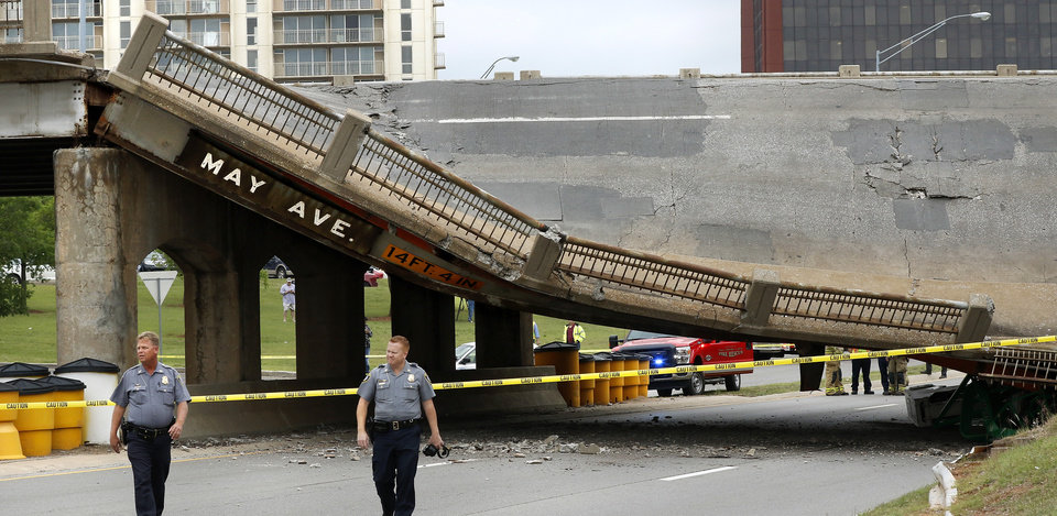 Photo - A section of the May Ave. bridge above the Northwest Expressway collapsed when  it was hit by a truck Thursday afternoon, in  Oklahoma City. No injuries were reported. This view shows the east side of the bridge. View is looking west. Photo by Jim Beckel, The Oklahoman.