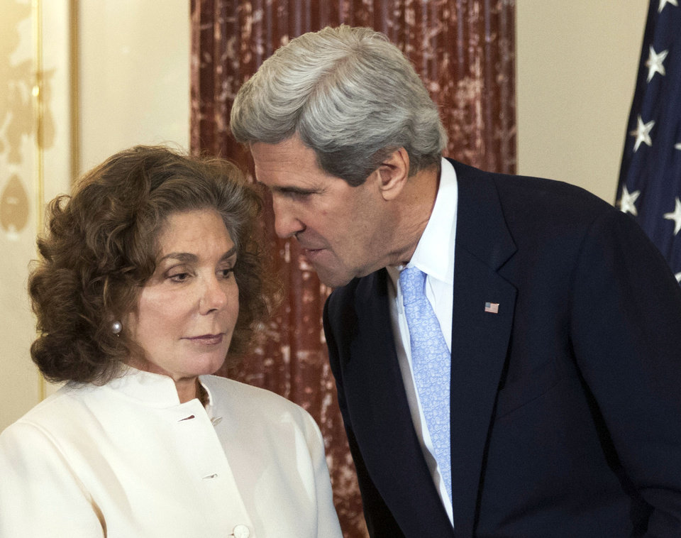 FILE - In this Feb. 6, 2013 file photo, Secretary of State John Kerry whispers to his wife Teresa Heinz Kerry during the ceremonial swearing-in for him as the secretary of state, at the State Department in Washington. Heinz Kerry was discharged from a Boston hospital Saturday July 27, 2013, just under three weeks after she suffered a seizure at their Nantucket home, a State Department spokesman said. Heinz Kerry, 74, is expected to make a full recovery from the July 7 seizure following additional outpatient treatment, spokesman Glen Johnson said.  (AP Photo/Manuel Balce Ceneta, File)