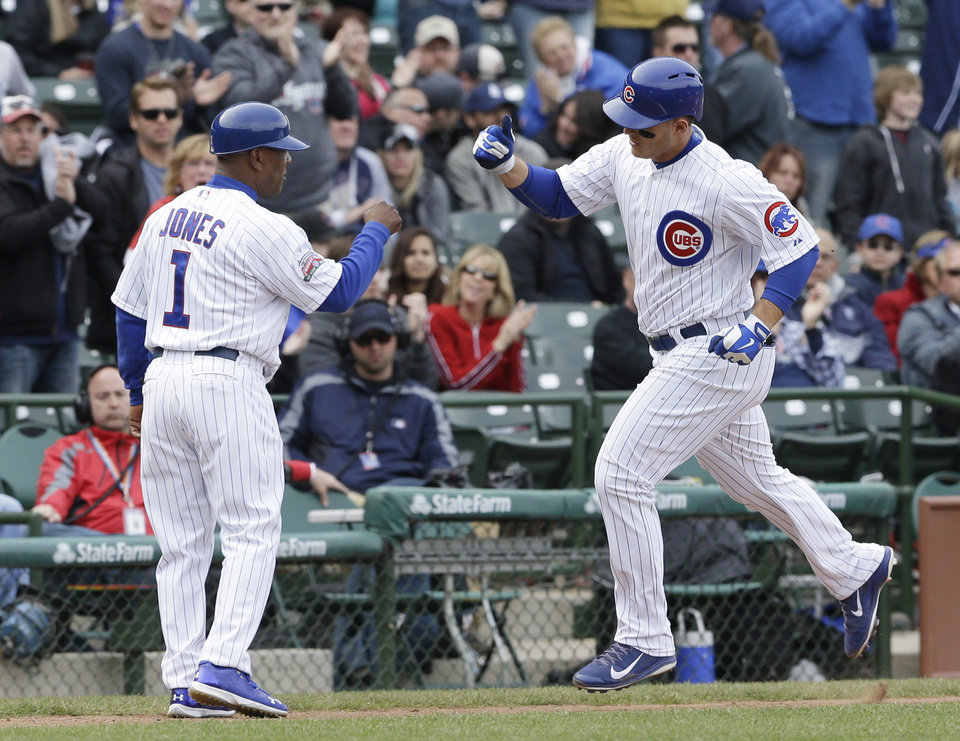 Photo - Chicago Cubs' Anthony Rizzo, right, celebrates with third base coach Gary Jones after hitting a solo home run during the eighth inning of a baseball game against the Arizona Diamondbacks in Chicago, Thursday, April 24, 2014. (AP Photo/Nam Y. Huh)