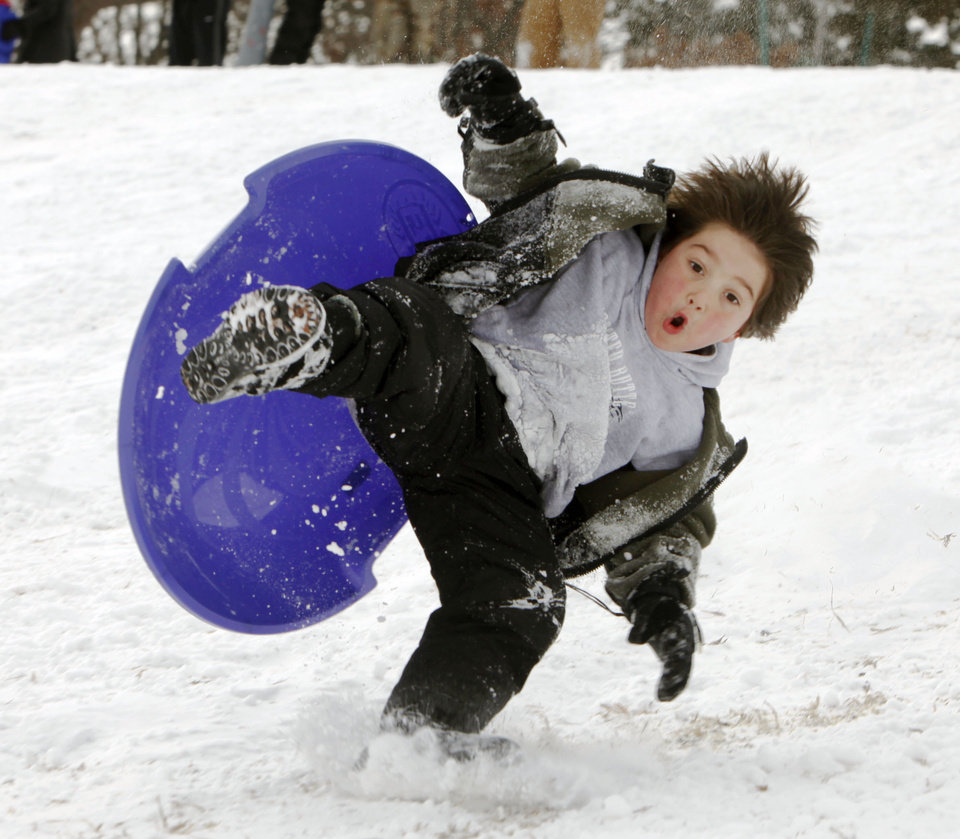 Photo - Five year old Edward Johnston hits jump at Douglas Park in Oklahoma City, OK, Thursday, Feb. 3, 2011. By Paul Hellstern, The Oklahoman
