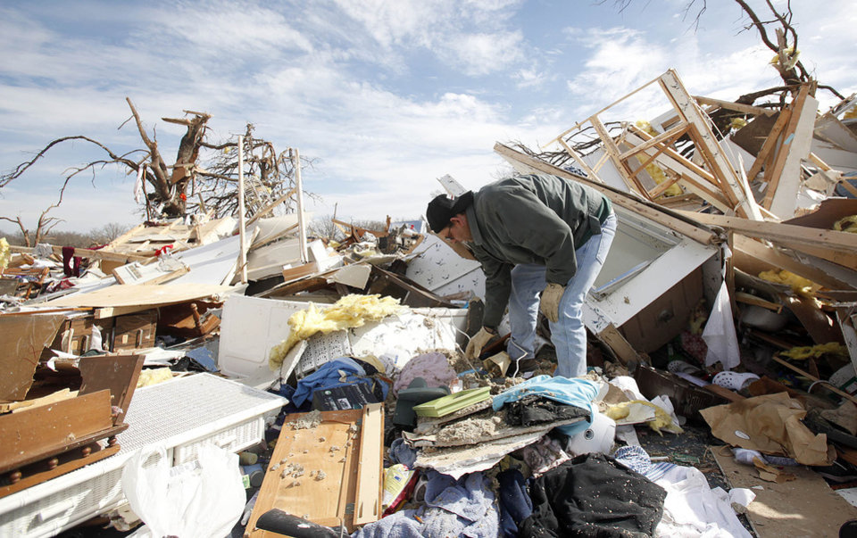 Photo - Jimmy Wyatt, stands on tornado damage at a friend's home who died in the storm in Lone Grove, Okla, Thursday, Feb, 12, 2009. PHOTO BY SARAH PHIPPS, THE OKLAHOMAN