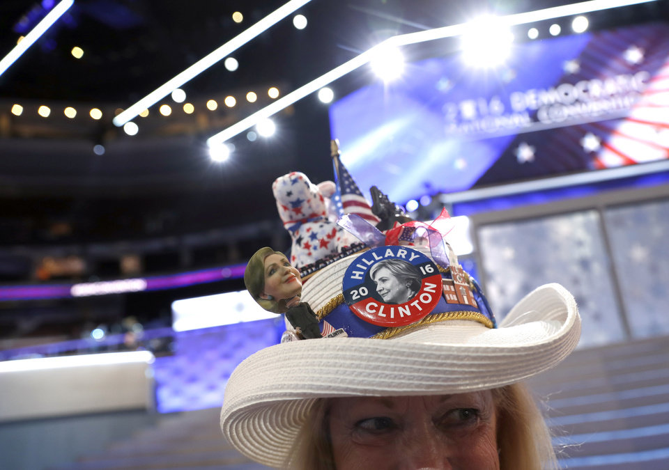 Photo - Mississippi delegate Joy Williams shows off her hat as she arrives at the convention floor before the start of the first day of the Democratic National Convention in Philadelphia, Monday, July 25, 2016. (AP Photo/Carolyn Kaster)