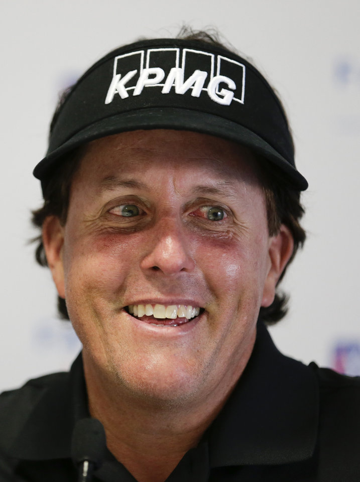 Photo - Phil Mickelson talks to the media during a news conference at the Farmers Insurance Open golf tournament at Torrey Pines Golf Course on Wednesday, Jan. 22, 2014, in San Diego. (AP Photo/Chris Carlson)