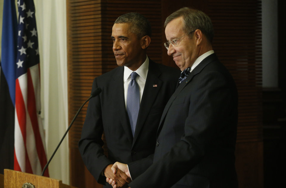 Photo - U.S. President Barack Obama, left, and Estonian President Toomas Hendrik Ilves shake hands at the end of a news conference at the Bank of Estonia in Tallinn, Estonia, Wednesday, Sept. 3, 2014. Obama is in Estonia for a one day visit where he will meet with Baltic State leaders before heading to the NATO Summit in Wales. (AP Photo/Charles Dharapak)