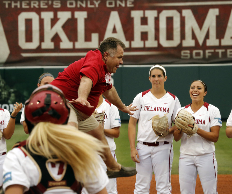 """Photo - Jim Routon, Moore tornado survivor and """"Big Dog"""" in a photograph by Paul Hellstern that appeared following the deadly tornado, threw out the first pitch and celebrated with a scissor kick before the University of Oklahoma Sooner (OU) softball team plays Tennessee in the first game of the NCAA super regional at Marita Hynes Field on May 23, 2014 in Norman, Okla. Photo by Steve Sisney, The Oklahoman"""