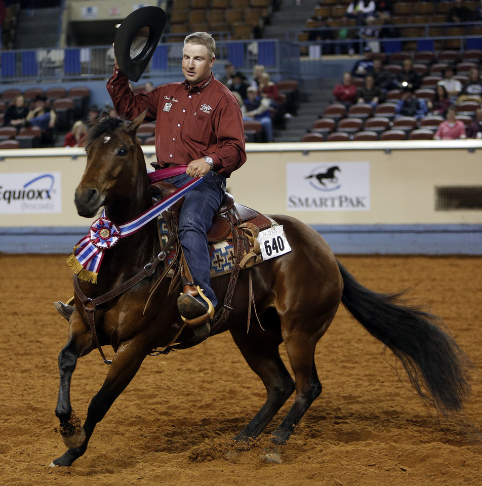 Corey Cushing, of Scottsdale, Ariz., rides Rising Starlight on Saturday during the American Quarter Horse Association World  Championship Show.  Photo by Garett Fisbeck, The Oklahoman