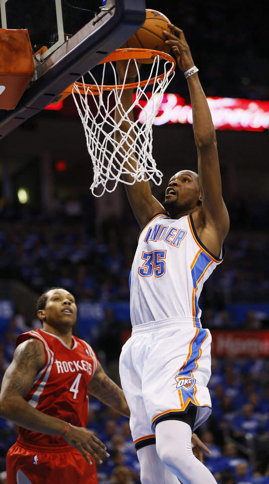 Photo - Oklahoma City's Kevin Durant (35) dunks in front of Houston's Greg Smith (4) during Game 1 in the first round of the NBA playoffs between the Oklahoma City Thunder and the Houston Rockets at Chesapeake Energy Arena in Oklahoma City, Sunday, April 21, 2013. Oklahoma City won, 120-91. Photo by Nate Billings, The Oklahoman