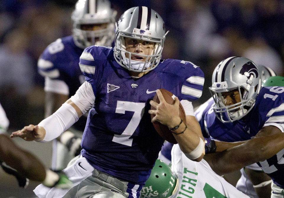 Photo -  Why Kansas State will win:   3. Collin Klein has been a dual-threat QB:  Klein's running abilities are well-documented, but he has been an efficient passer through three games this season, too. Klein has completed 72 percent of his passes with five touchdowns through the air, in addition to his 4.6 yards-per-carry rushing average.      Photo:  Kansas State quarterback Collin Klein gets past North Texas linebacker Will Wright during the second half of a Sept. 15 game in Manhattan, Kan. (AP Photo/Orlin Wagner)