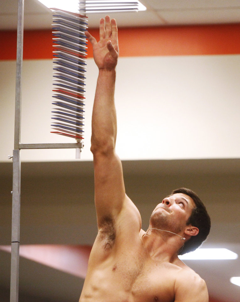 Photo - Receiver Charlie Moore does a vertical leap during a workout at Oklahoma State's pro day held at Boone Pickens Stadium in Stillwater on Thursday, March 13, 2014. Photo by KT King, The Oklahoman