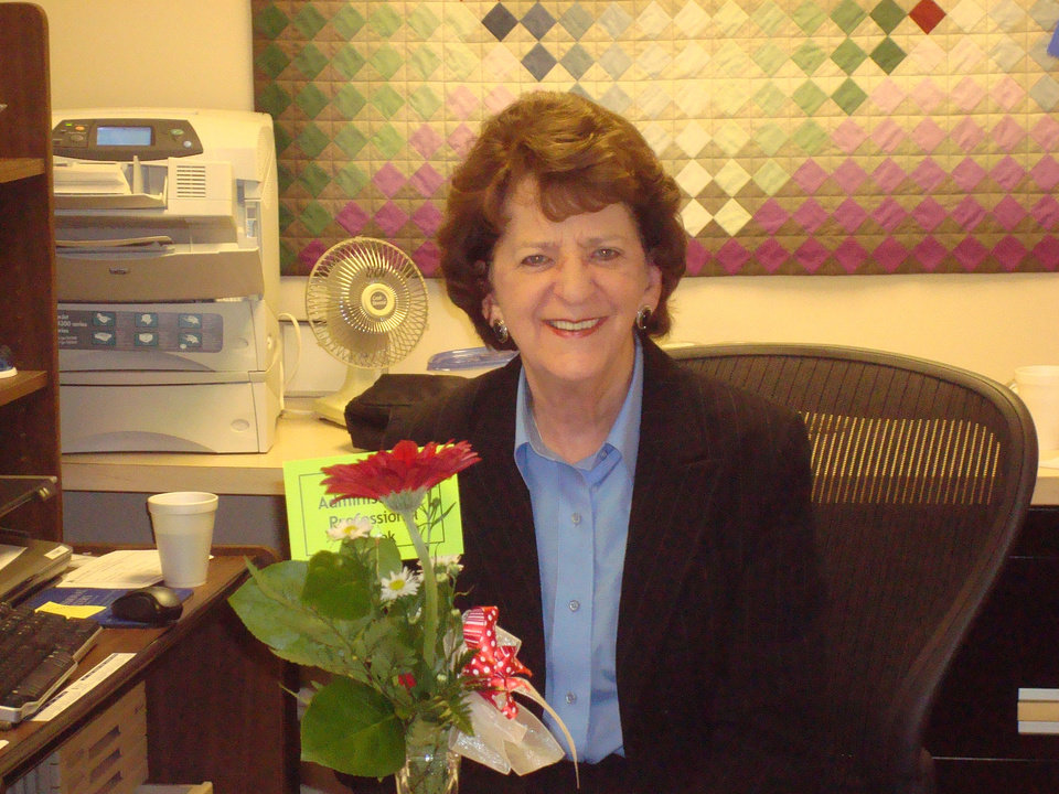 Jo Balding, a paralegal with Crowe & Dunlevy, is pictured at her desk with one of her handmade quilts in the background. PHOTO PROVIDED