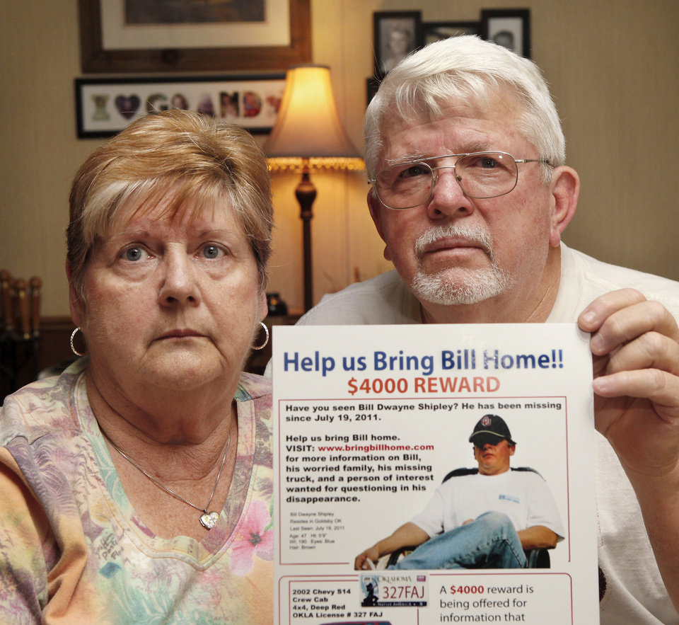 Patricia and William Shipley remain hopeful their son will be located.  The couple, who live in rural Cleveland County,  show the reward poster they have circulated across the state in an attempt to find him. Bill Dwayne Shipley has been missing for a year. He was reported missing on July 19, 2011.  They were photographed in their home on July 18, 2012. Photo by Jim Beckel, The Oklahoman.