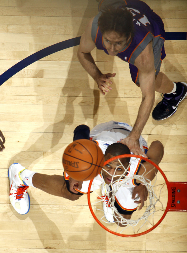 Photo - Oklahoma City's Russell Westbrook (0) and Phoenix's Steve Nash postion for a rebound during the NBA basketball game between  the Oklahoma City Thunder and the Phoenix Suns, Sunday, Dec. 19, 2010, at the Oklahoma City Arena. Photo by Sarah Phipps, The Oklahoman