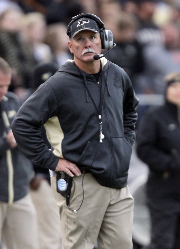Purdue head coach Danny Hope watches a replay on the scoreboard as his team play against Michigan during the second half of an NCAA college football game in West Lafayette, Ind., Saturday, Oct. 6, 2012. Michigan defeated Purdue 44-13. (AP Photo/Michael Conroy)