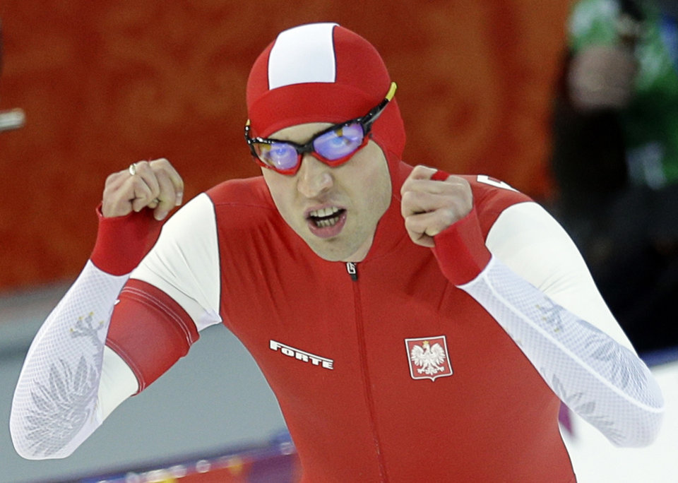 Photo - Poland's Zbigniew Brodka  celebrates after racing in the men's 1,500-meter speedskating at the Adler Arena Skating Center during the 2014 Winter Olympics in Sochi, Russia, Saturday, Feb. 15, 2014. (AP Photo/Patrick Semansky)