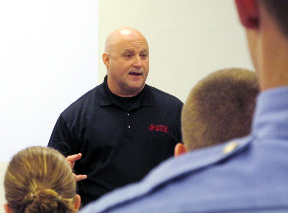 Photo - Oklahoma City police gang unit Detective Tim Hock teaches a cadet class on gangs in March at the Oklahoma City police academy. Hock has worked on the department's gang unit for 19 years: 10 years on the unit's street team and nine as a unit detective.  Photo by LeighAnne Manwarren, The Oklahoman