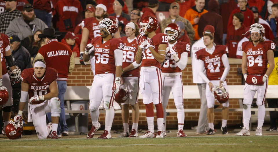 Photo - The Oklahoma bench watches during overtime of a Bedlam college football game between the University of Oklahoma Sooners (OU) and the Oklahoma State Cowboys (OSU) at Gaylord Family-Oklahoma Memorial Stadium in Norman, Okla., Saturday, Dec. 6, 2014. Photo by Bryan Terry, The Oklahoman