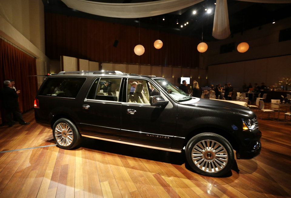 Photo - The new 2015 Lincoln Navigator is unveiled in Detroit, Tuesday, Jan. 21, 2014. Lincoln Motor Co. _ Ford's luxury arm _ says the new Navigator will have more than 20 upgrades, from bigger wheels and a leather-wrapped steering wheel to a 3.5-liter EcoBoost V6 engine to replace its old V8. Lincoln plans to publicly unveil the vehicle at the Chicago Auto Show. The SUV _ which will be built in Kentucky _ goes on sale this fall. (AP Photo/Carlos Osorio)