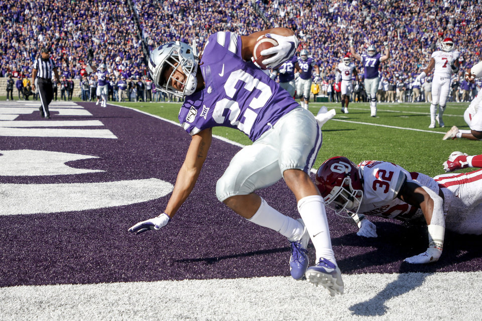 Photo - Kansas State wide receiver Joshua Youngblood (23) scores a touchdown against Oklahoma safety Delarrin Turner-Yell (32) during the first half of an NCAA football game at Bill Snyder Family Stadium in Manhattan, Kan., Saturday, Oct. 26, 2019. (Ian Maule/Tulsa World via AP)