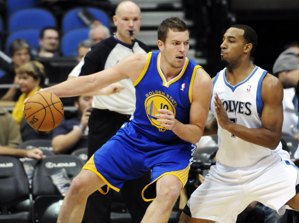 Golden State Warriors' David Lee, left, works his way around Minnesota Timberwolves' Derrick Williams in the first half of an NBA basketball game on Friday, Nov. 16, 2012 in Minneapolis. (AP Photo/Jim Mone)