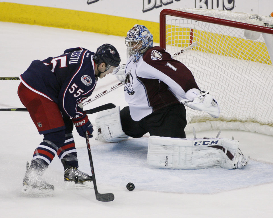 Photo - Columbus Blue Jackets' Mark Letestu (55) misses from short range against Colorado Avalanche goalie Semyon Varlamov (1) during the third period of an NHL hockey game, Tuesday, April 1, 2014, in Columbus, Ohio. (AP Photo/Mike Munden)