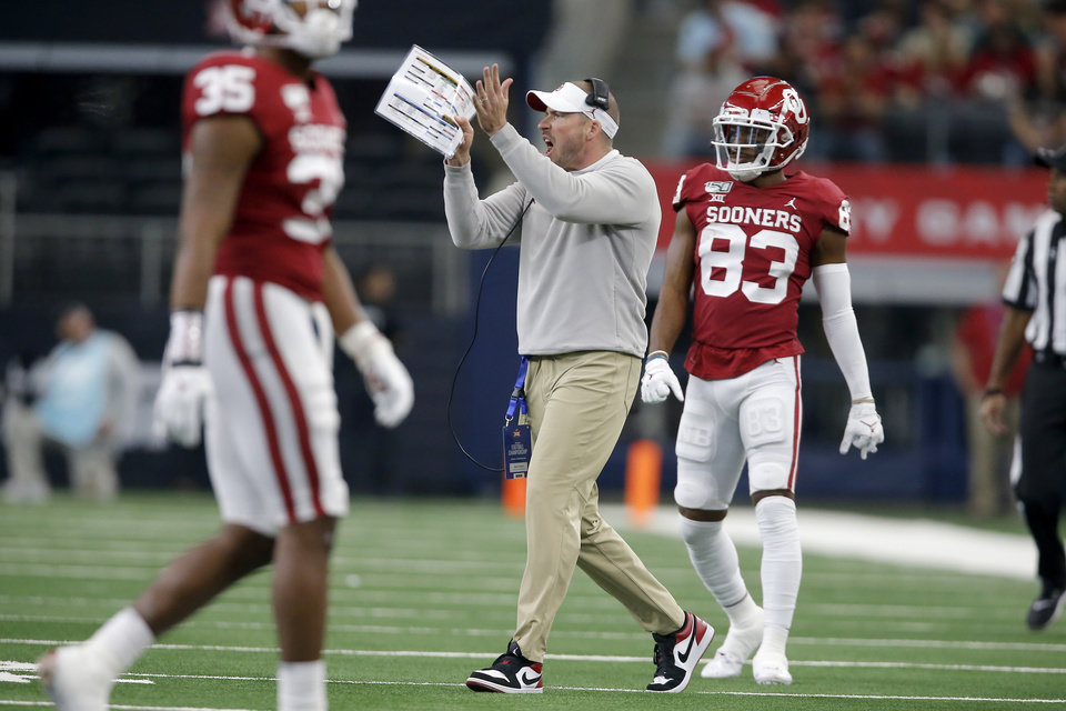 Photo - Oklahoma defensive coordinator Alex Grinch shouts instructions the Big 12 Championship Game between the University of Oklahoma Sooners (OU) and the Baylor University Bears at AT&T Stadium in Arlington, Texas, Saturday, Dec. 7, 2019. Oklahoma won 30-23. [Bryan Terry/The Oklahoman]