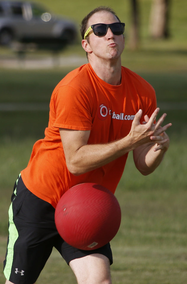Photo -  Stephen Oertel tries to catch the ball during a kickball game demonstration for the World Adult Kickball League in Oklahoma City. Photo by Bryan Terry, The Oklahoman   Bryan Terry -  THE OKLAHOMAN