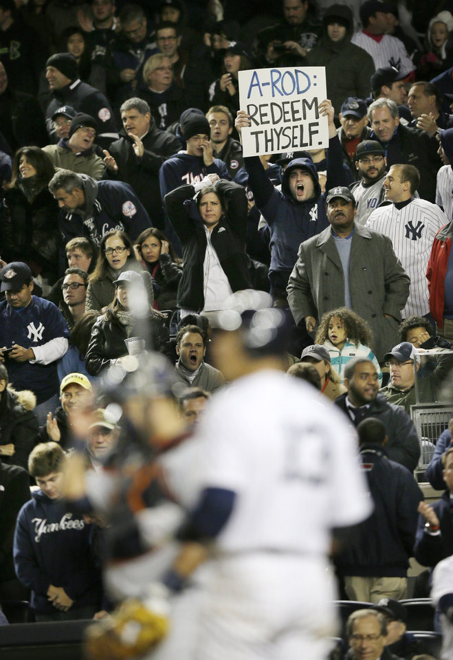 Photo -   Fans jeer New York Yankees Alex Rodriguez in the sixth inning during Game 1 of the American League championship series against the Detroit Tigers Saturday, Oct. 13, 2012, in New York. (AP Photo/Matt Slocum)