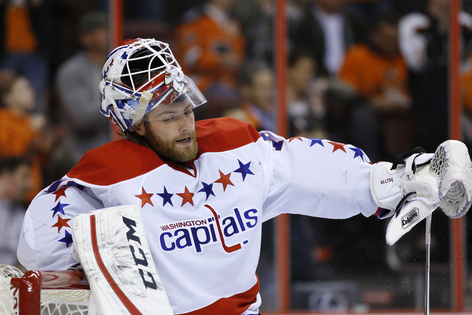 Photo - Washington Capitals' Braden Holtby rests on the goal after giving up a goal to Philadelphia Flyers' Michael Raffl, of Austria, during the second period of an NHL hockey game, Wednesday, March 5, 2014, in Philadelphia. (AP Photo/Matt Slocum)
