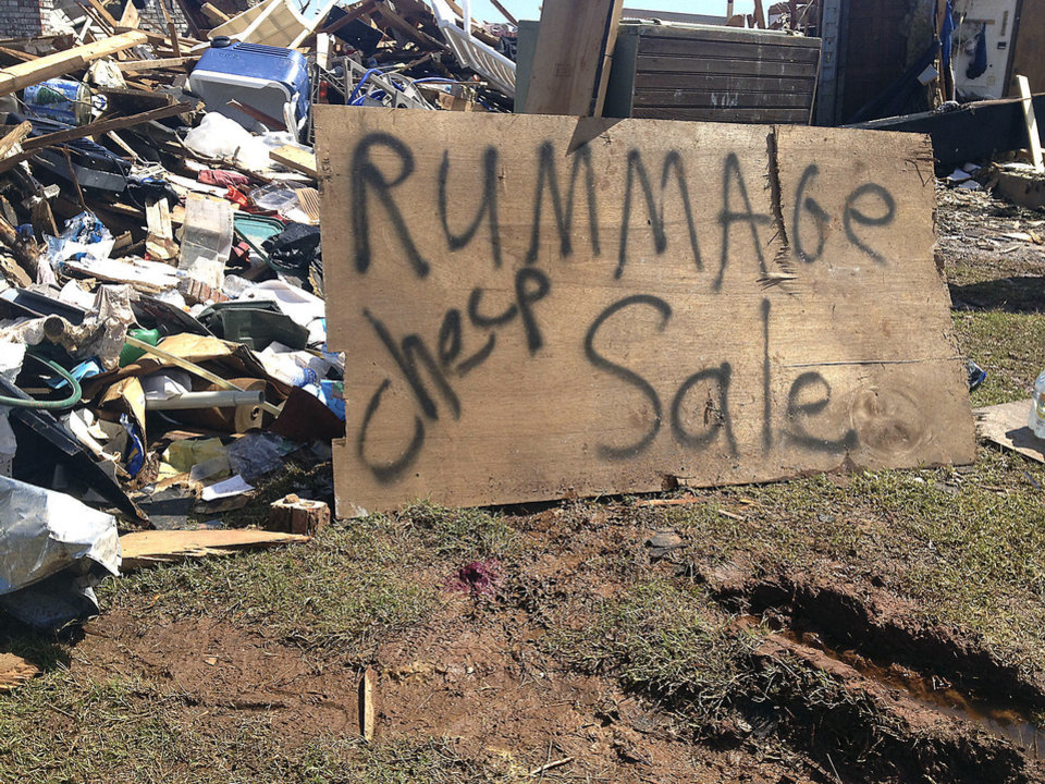 "Tom Bridges' house was destroyed in Moore on Monday, May 20. He put a sign up that said ""Rummage sale-cheap"" to get 'A laugh out of all this mess. We need that,"" the Army veteran, 68, said. The sign drew attention from passers-by.  <strong></strong>"