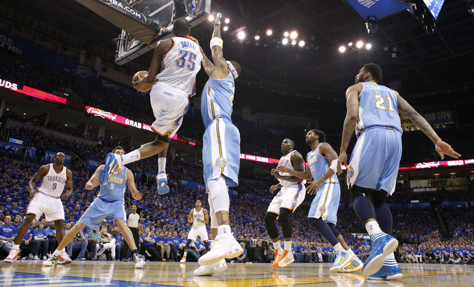 Photo - Oklahoma City's Kevin Durant (35) drives past Denver's Kenyon Martin (4) during the first round NBA playoff game between the Oklahoma City Thunder and the Denver Nuggets on Sunday, April 17, 2011, in Oklahoma City, Okla. Photo by Chris Landsberger, The Oklahoman