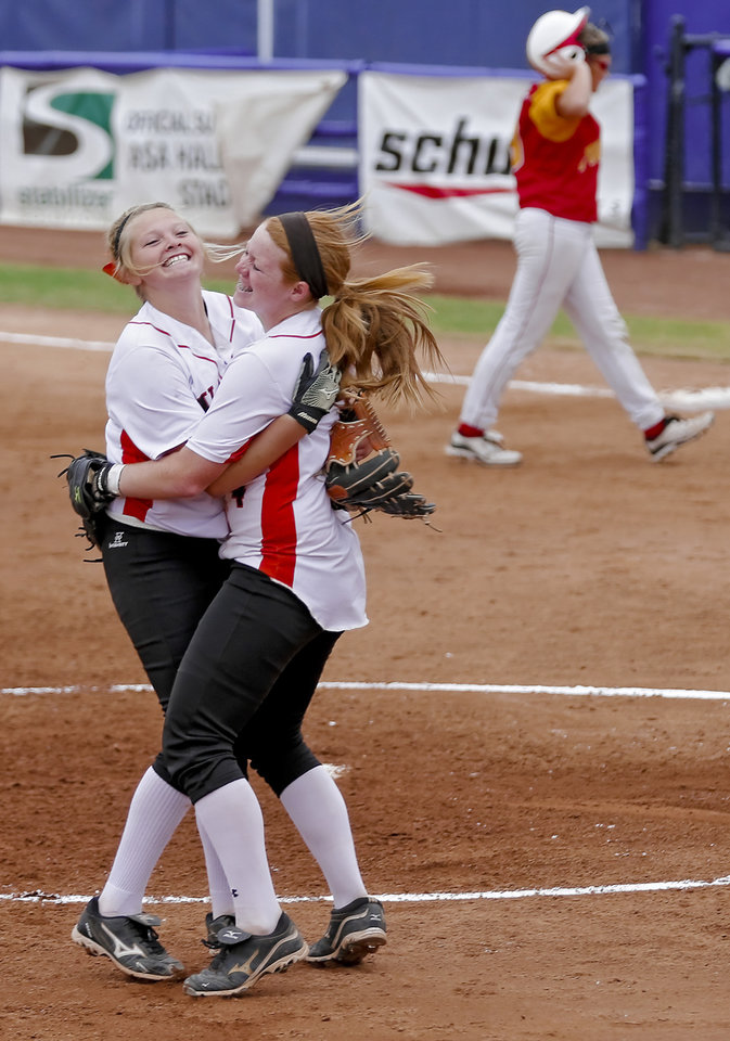 HIGH SCHOOL SOFTBALL TOURNAMENT / CELEBRATION: Wayne\'s Michal Hylton, left, and Chloe Clifton (4) celebrate the win during the Oklahoma State Softball tournament game between Wayne and Dale at ASA Hall of Fame Stadium on Thursday, Oct. 4, 2012, in Oklahoma City, Okla. Photo by Chris Landsberger, The Oklahoman