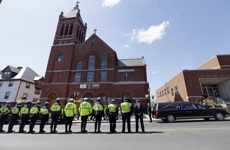 Photo - Medford and Somerville police line the street outside St. Joseph's Church in Medford, Mass. Monday, April 22, 2013 for the funeral of Boston Marathon bomb victim Krystle Campbell, 29. (AP Photo/Elise Amendola)
