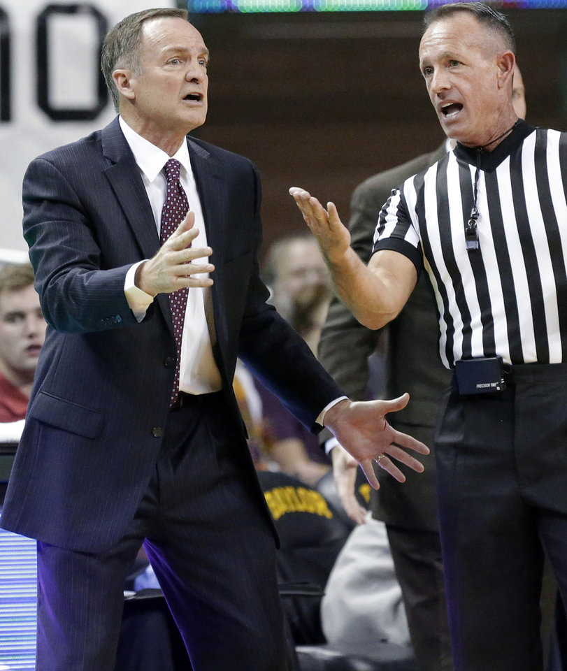 Photo - Oklahoma head coach Lon Kruger, left, argues a call with referee Darron George during the first half of an NCAA college basketball game Baylor Saturday, Jan. 18, 2014, in Waco, Texas. (AP Photo/LM Otero)