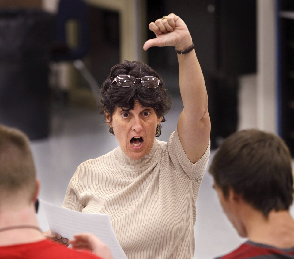 Bonnie Sneed, director of choirs at Choctaw High School,  rehearses with members of one of her choral groups.     Photo by Jim Beckel, The Oklahoman <strong>Jim Beckel - THE OKLAHOMAN</strong>