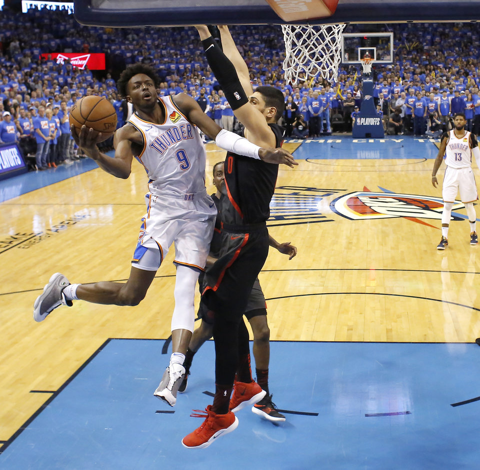Photo - Oklahoma City's Jerami Grant (9) goes to the basket beside Portland's Enes Kanter (00) during Game 4 in the first round of the NBA playoffs between the Portland Trail Blazers and the Oklahoma City Thunder at Chesapeake Energy Arena in Oklahoma City, Sunday, April 21, 2019. Photo by Bryan Terry, The Oklahoman